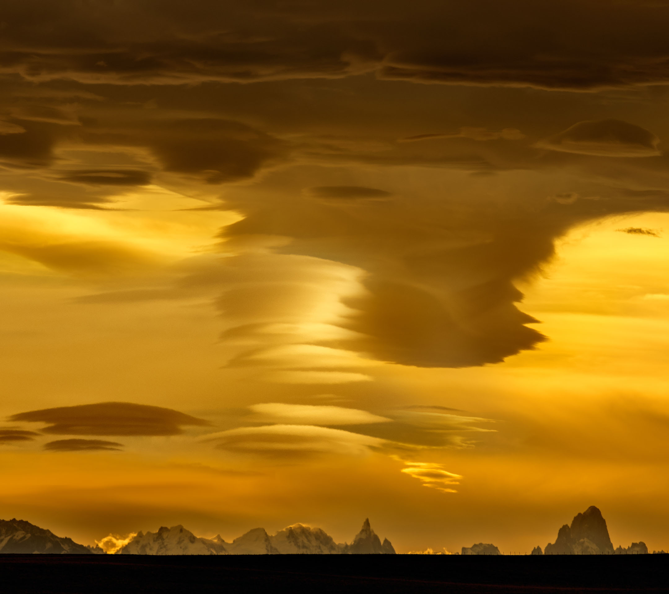 Panorama of Mt Fitz Roy and Cerro Torre under lenticular clouds at sunset – Mirador Julio Heredia